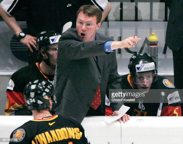 Team manager Greg Poss speaks to the team during the IIHF World Men?s Championships Preliminary Round match between Czech Republic and Germany on May...