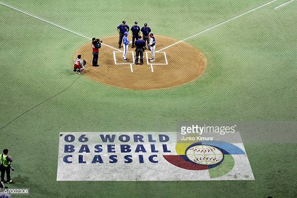 Team manager InSik Kim of Korea and Team manager Sadaharu Oh of Japan meet at homeplate during the first round of the 2006 World Baseball Classic on...