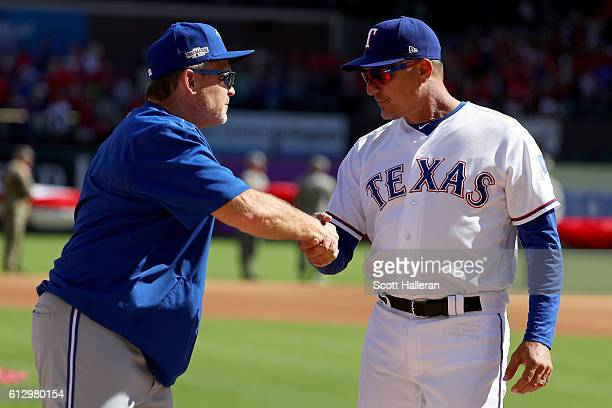 Team manager John Gibbons of the Toronto Blue Jays and Team manager Jeff Banister of the Texas Rangers shake hands prior to game one of the American...