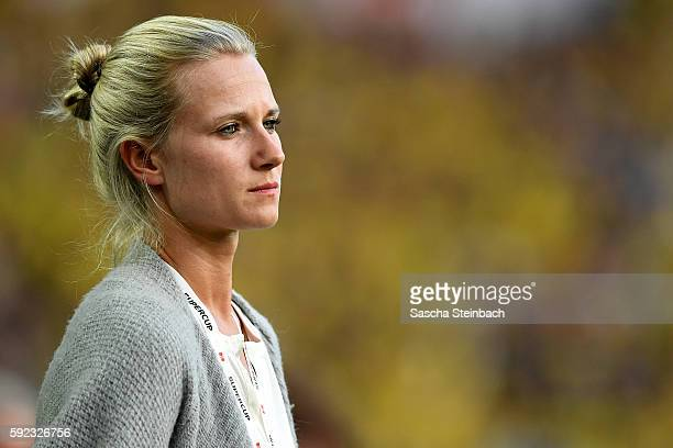 Team manager Kathleen Krueger looks on during the DFL Supercup 2016 match between Borussia Dortmund and FC Bayern Muenchen at Signal Iduna Park on...
