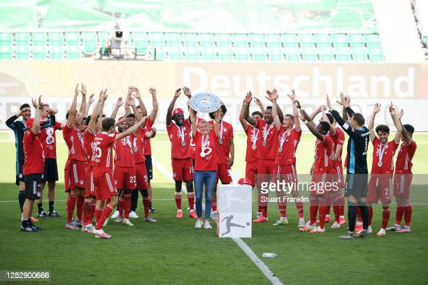 Team manager Kathleen Krueger of FC Bayern Muenchen lifts the trophy to celebrate the championship following the Bundesliga match between VfL...