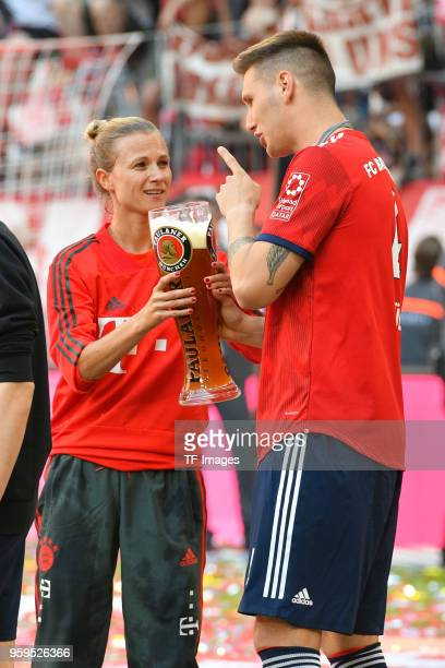 Team manager Kathleen Krueger speaks with Niklas Suele of Muenchen after the Bundesliga match between FC Bayern Muenchen and VfB Stuttgart at Allianz...
