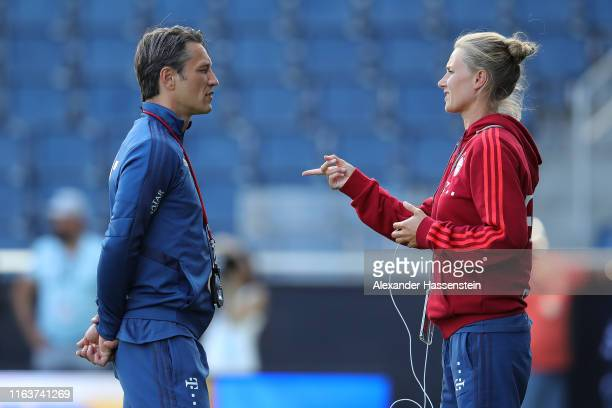 Team manager Kathleen Krueger talks to head coach Niko Kovac of FC Bayern Muenchen during a training session at Children`s Mercy Park during the...