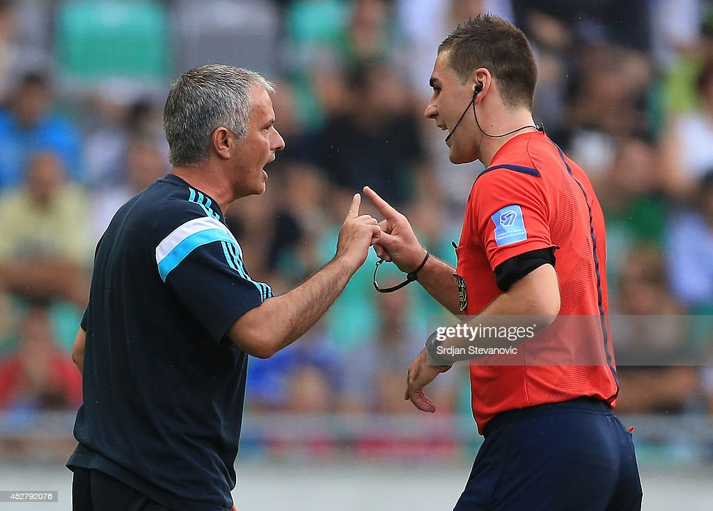 Team manager of Chelsea Jose Mourinho (L) argues with the referee during the Pre Season Friendly match between FC Olimpija Ljubljana and Chelsea at Stozice stadium in Ljubljana, Slovenia on Sunday, July 27, 2014.