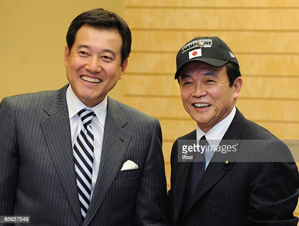 Team manager of Japan's World Baseball Classic squad Tatsunori Hara and Japanese Prime Minister Taro Aso pose for a photo at Aso's official residence...