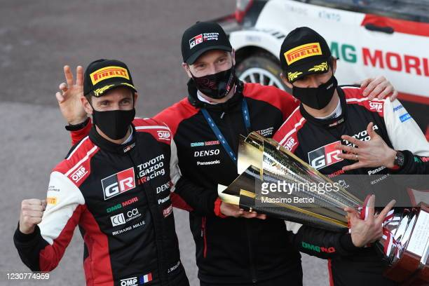 Team Manager of Toyota Gazoo Racing WRT, Jari Matti Latvala of Finland, poses for a photo with Sebastien Ogier and Julien Ingrassia of France during...