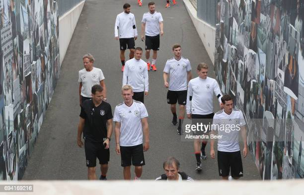 Team manager Oliver Bierhoff and players of the German national soccer team arrive for a training session on June 9 2017 in Herzogenaurach Germany...