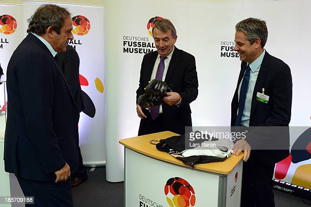 Team Manager Oliver Bierhoff hands over one of his kits from the EURO 96 final to Manuel Neukirchner of the German Football Museum while UEFA...