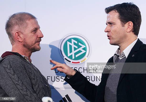 Team manager Oliver Bierhoff of Germany and director Soenke Wotmann chat after a Germany press conference at MerzedesBenz center on February 27 2012...