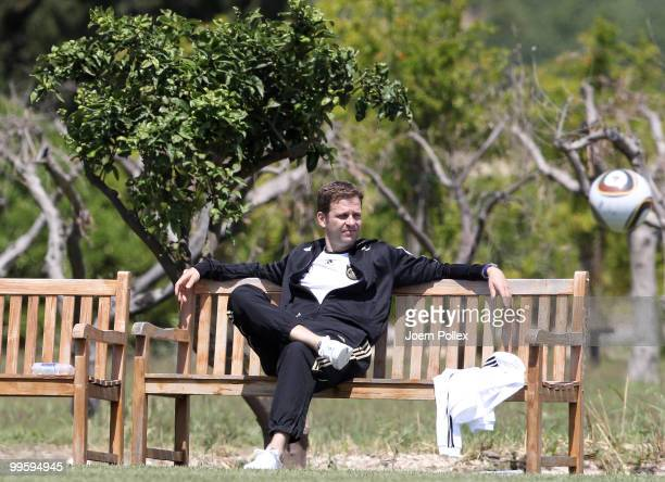 Team manager Oliver Bierhoff of Germany sits on a bench during the German National Team training session at Verdura Golf and Spa Resort on May 16,...