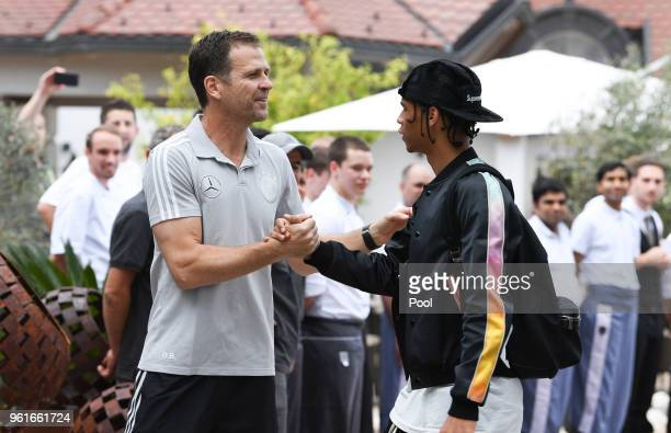 Team Manager Olivier Bierhoff greets Leroy Sane as he arrives on day one of the Germany National Football team's training camp at Hotel Weinegg on...