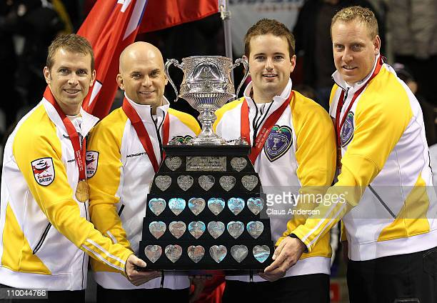 Team Manitoba Jeff Stoughton Jon Mead Reid Carruthers and Steve Gould hoist the Brier Championship trophy after defeating Team Ontario in the 2011...
