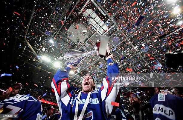Team Mannheim celebrates with the trophy winning of the German Championship after the end of the DEL Bundesliga play off third final game between...