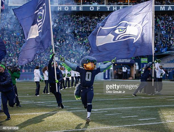 Team mascot Blitz of the Seattle Seahawks takes the field during the Seahawks' Super Bowl XLVIII Victory Parade ceremonies at CenturyLink Field on...