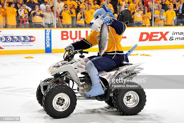 Team mascot Gnash carries a catfish off the ice after the Nashville Predators defeated the Detroit Red Wings in Game Five of the Western Conference...