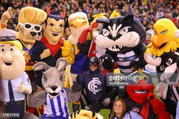 AFL team mascots pose for a photo before the EJ Whitten Legends AFL game between Victoria and the All Stars at Etihad Stadium on July 10 2013 in...