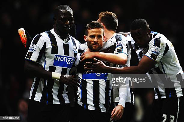 A team mate holds a bottle as Yohan Cabaye of Newcastle United is congratulated by team mates after scoring his sides third goal during the Barclays...