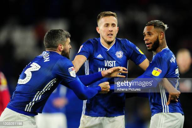 Team mates Callum Paterson and Leandro Bacuna are separated by Will Vaulks of Cardiff City during the Sky Bet Championship match between Cardiff City...