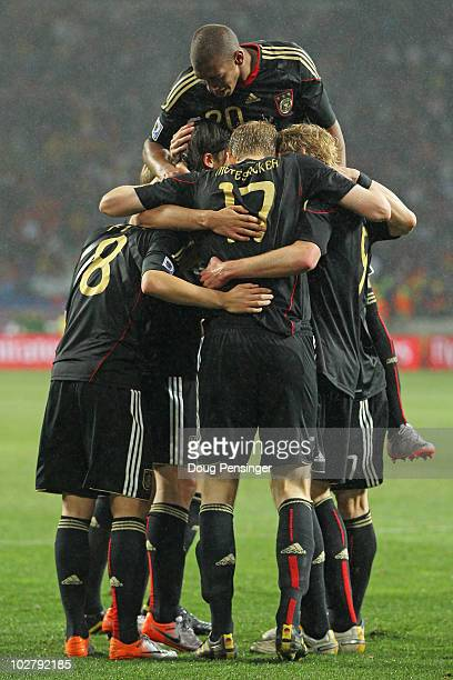 Team mates celebrate as Sami Khedira of Germany scores his team's third goal during the 2010 FIFA World Cup South Africa Third Place Playoff match...