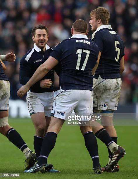 Team mates congratulate Greig Laidlaw of Scotland at full time during the RBS 6 Nations match between Scotland and Ireland at Murrayfield Stadium on...