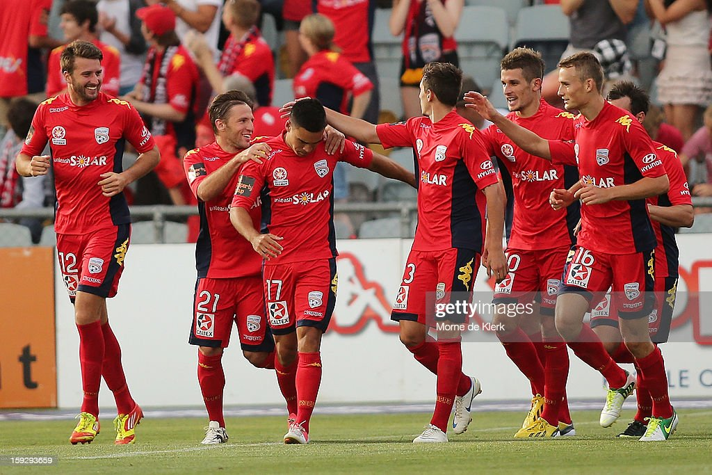 Team mates congratulate Iain Ramsey of Adelaide after he scored a goal during the round 16 A-League match between Adelaide United and the Perth Glory at Hindmarsh Stadium on January 11, 2013 in Adelaide, Australia.