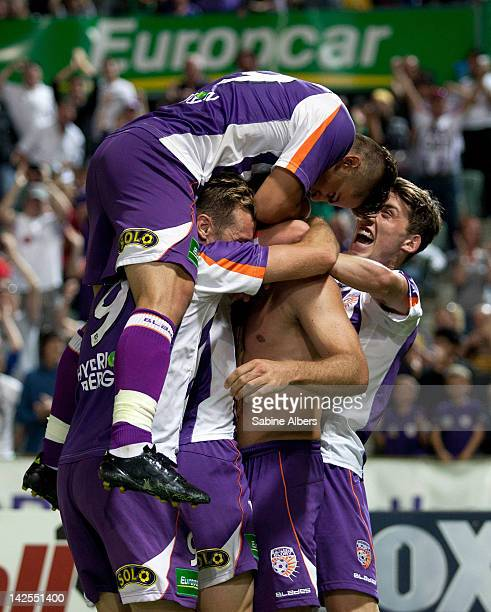 Team mates congratulate Todd howarth from the Perth Glory after scoring the final goal during the A-League Elimination final match between Perth...
