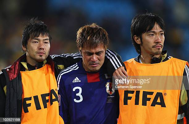Team mates console Yuichi Komano of Japan after he missed in a penalty shootout during the 2010 FIFA World Cup South Africa Round of Sixteen match...