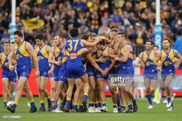 Team mates get around Andrew Gaff of the Eagles after kicking a goal during the round 20 AFL match between the West Coast Eagles and the Fremantle...