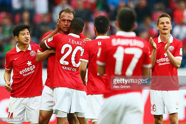 Team mates hug Nikolce Noveski of Mainz during the Bundesliga match between 1 FSV Mainz 05 and 1 FC Koeln at Coface Arena on May 16 2015 in Mainz...