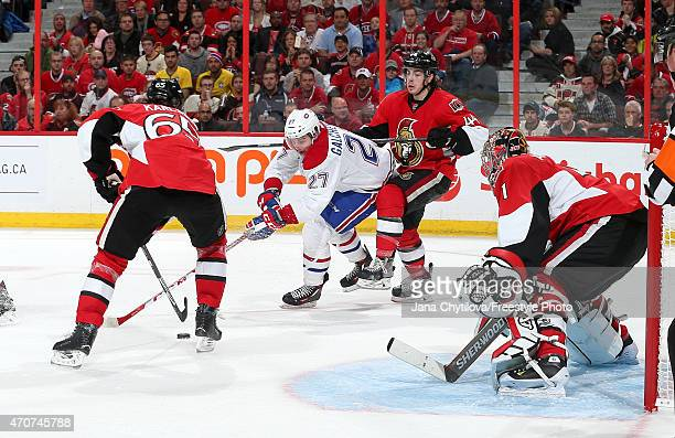 Team mates JeanGabriel Pageau Erik Karlsson and Craig Anderson of the Ottawa Senators defend against Alex Galchenyuk of the Montreal Canadiens as he...