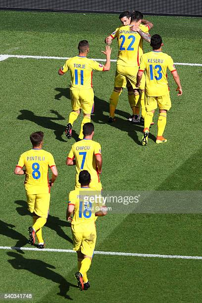 Team mates of Bogdan Stancu of Romania celebrate with him after he scored his sides first goal during the UEFA EURO 2016 Group A match between...
