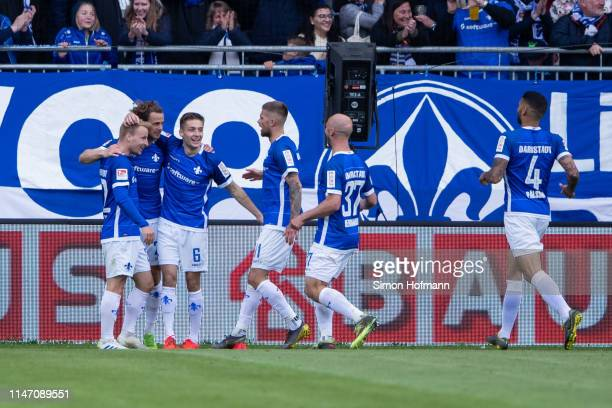 Team mates of Darmstadt celebrate their first goal during the Second Bundesliga match between SV Darmstadt 98 and 1 FC Union Berlin at...