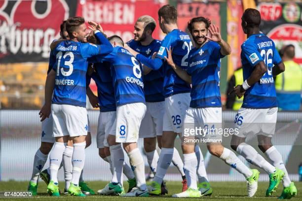 Team mates of Darmstadt celebrate their third goal during the Bundesliga match between SV Darmstadt 98 and SC Freiburg at Stadion am Boellenfalltor...