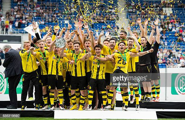 Team mates of Dortmund celebrate with the trophy after the A Juniors German Championship Final match between 1899 Hoffenheim U19 and Borussia...