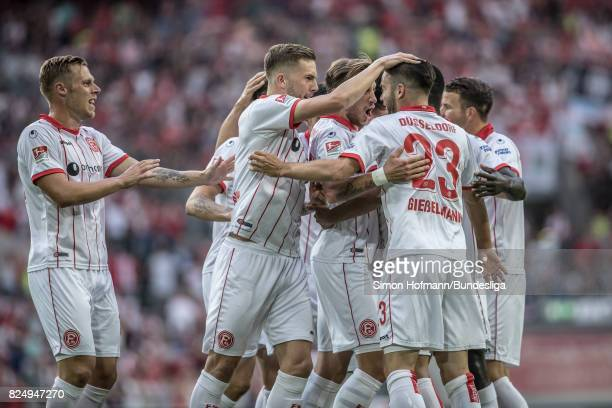 Team mates of Duesseldorf celebrate their first goal during the the Second Bundesliga match between Fortuna Duesseldorf and Eintracht Braunschweig at...