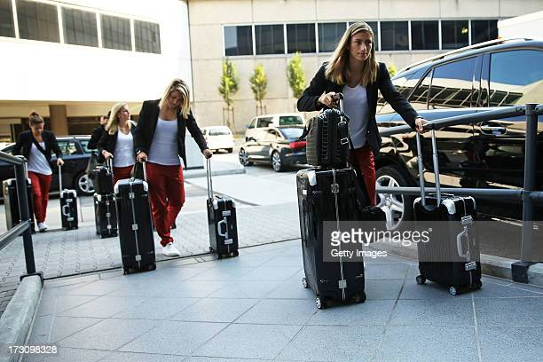 Team mates of Germany arrive for the Germany women's national team departure to Sweden at Frankfurt Airport on July 7 2013 in Frankfurt am Main...
