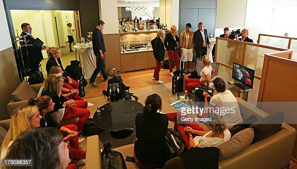 Team mates of Germany wait for their flight during the Germany women's national team departure to Sweden at Frankfurt Airport on July 7 2013 in...