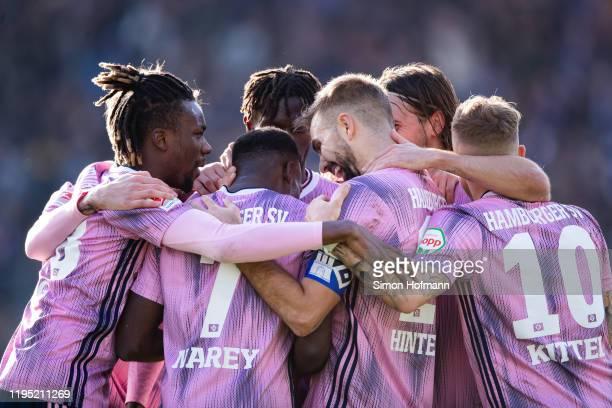 Team mates of Hamburg celebrate their first goal during the Second Bundesliga match between SV Darmstadt 98 and Hamburger SV at Merck-Stadion am...