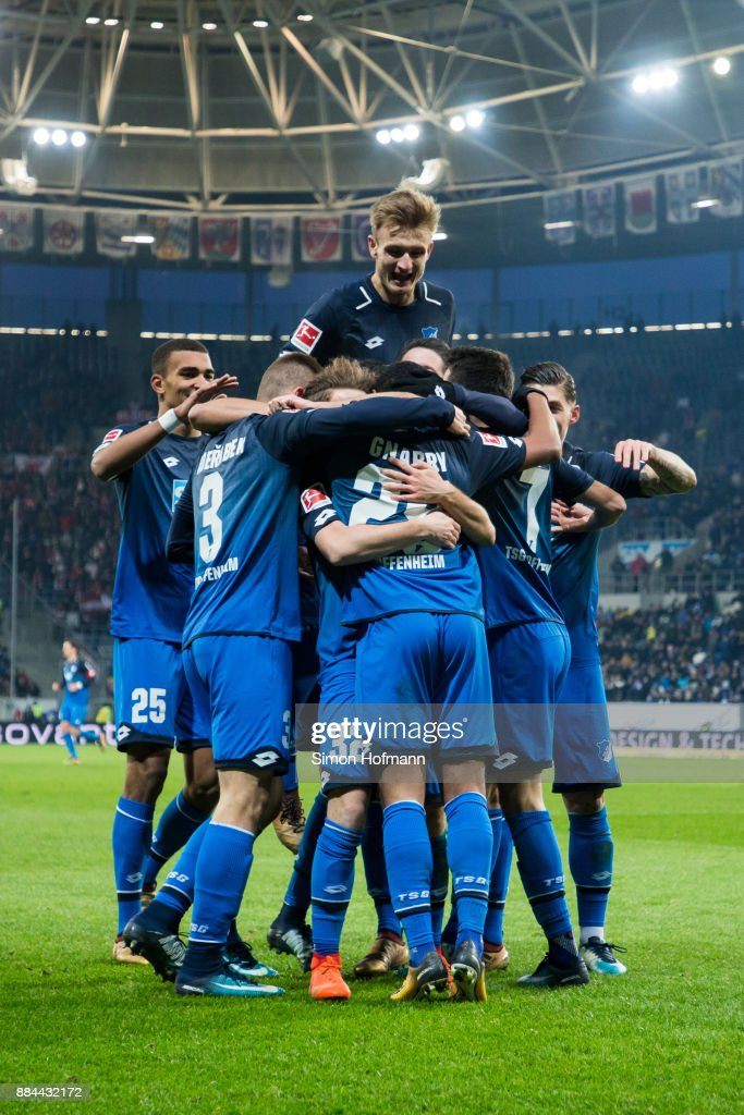 Team mates of Hoffenheim celebrate their seond goal during the Bundesliga match between TSG 1899 Hoffenheim and RB Leipzig at Wirsol Rhein-Neckar-Arena on December 2, 2017 in Sinsheim, Germany.
