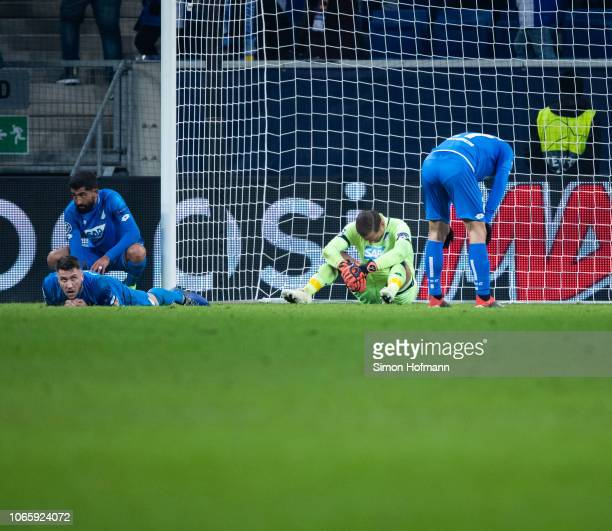 Team mates of Hoffenheim react after Taison of Donetsk scored his side's third goal during the UEFA Champions League Group F match between TSG 1899...