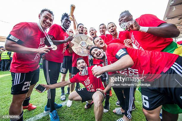 Team mates of Ingolstadt celebrate winning after during the Second Bundesliga match between FC Ingolstadt and RB Leipzig at Audi Sportpark on May 17...
