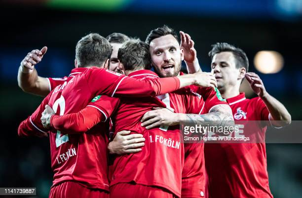 Team mates of Koeln celebrate their second goal during the Second Bundesliga match between SpVgg Greuther Fuerth and 1 FC Koeln at Sportpark Ronhof...