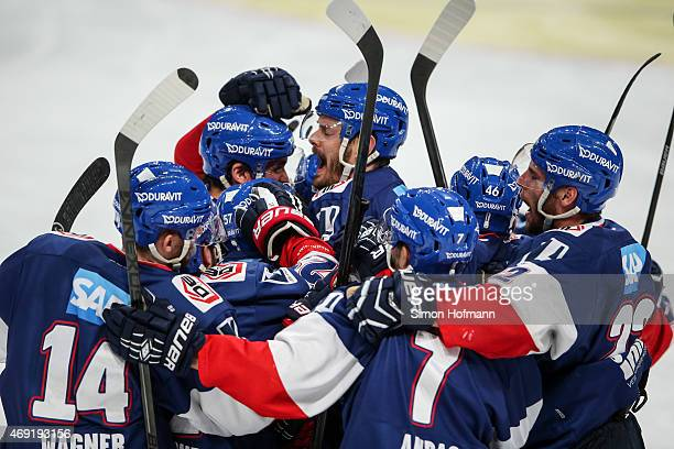 Team mates of Mannheim celebrate their second goal during the DEL Playoffs Final Game 1 between Adler Mannheim and ERC Ingolstadt at SAP Arena on...