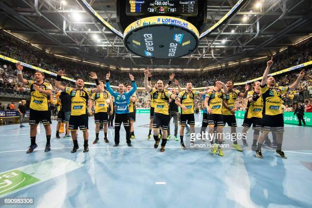 Team mates of RheinNeckar Loewen celebrate after the DKB HBL match between RheinNeckar Loewen and THW Kiel at SAP Arena on May 31 2017 in Mannheim...