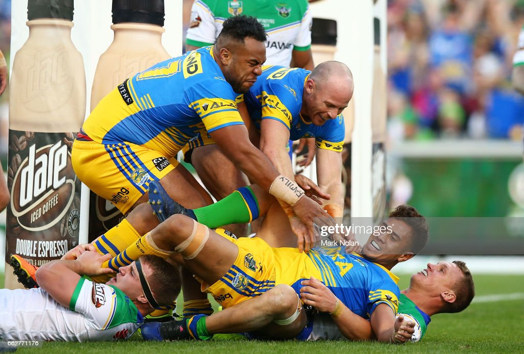 Team mates rush to congratulate Kaysa Pritchard of the Eels after he scored during the round five NRL match between the Canberra Raiders and the Parramatta Eels at GIO Stadium on April 1, 2017 in Canberra, Australia.