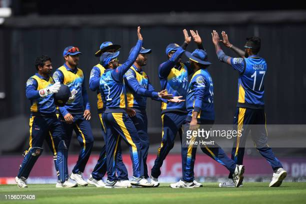 Team mates rush to conratulate Isuru Udana of Sri Lanka for catching Usman Khawaja of Australia during the Group Stage match of the ICC Cricket World...