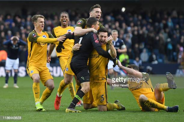 Team mates Solly March, Bernado, Shane Duffy, Lewis Dunk and Dale Stephens rush to celebrate with goalkeeper Matthew Ryan of Brighton & Hove Albion...