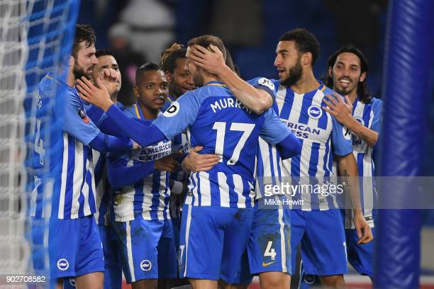 Team mates surround Glenn Murray of Brighton after his winner during The Emirates FA Cup Third Round match between Brighton Hove Albion and Crystal...