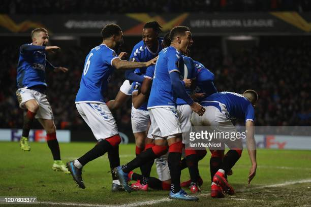 Team mates surround Ianis Hagi of Rangers after he scores the winning goal during the UEFA Europa League round of 32 first leg match between Rangers...