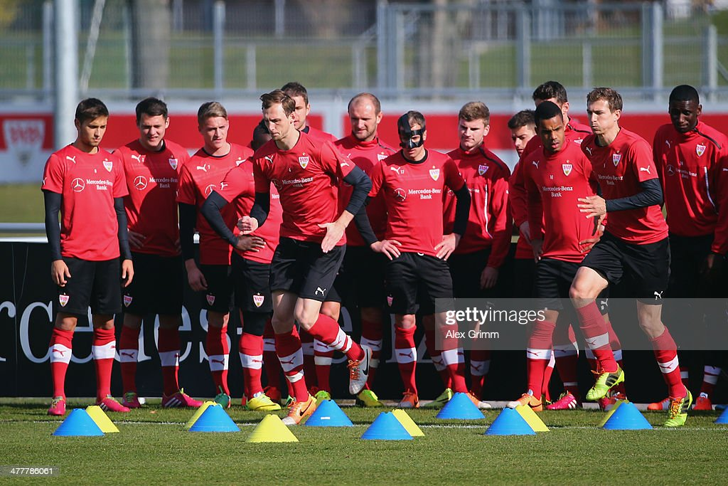 Team mates watch Georg Niedermeier (front L) and Daniel Schwaab (R) exercise during a VfB Stuttgart training session at the club's training ground on March 11, 2014 in Stuttgart, Germany.